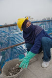 Bangkok, Thailand, women workers on the top of a building site Stock Photos