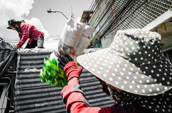 Bangkok, Thailand : Workers or employees carrying flowers Stock Photography