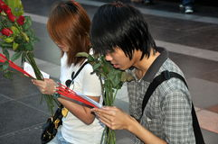 Bangkok, Thailand: Young Couple at Prayer Stock Photo