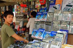 Bangkok, Thailand: Youth Selling Calculators Royalty Free Stock Images