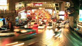 Bangkok traffic jam at night, time lapse. Zoom out stock footage