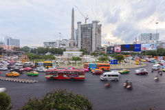 Bangkok traffic at Victory monument. Bangkok, Thailand - July 18, 2015: Bangkok traffic at Victory monument. Bangkok is famous for its heavy traffic congestion Stock Photo