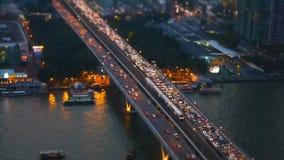 Bangkok transportation on bridge across Chaopraya river. Speed video high view of transportation by boat on Chaopraya river and car on Taksin bridge in Bangkok stock video footage