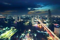 Bangkok Transportation at Dusk along the river ;Thailand. Bangkok Transportation at Dusk with Modern Business Building along the river (Thailand Stock Image