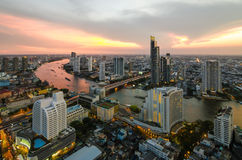 Bangkok Transportation at Dusk with Modern Business Building alo. Ng the river (Thailand Royalty Free Stock Photography