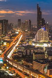 Bangkok Transportation at Dusk with Modern Business Building alo. Ng the river (Thailand Royalty Free Stock Photography