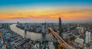 Bangkok Transportation at Dusk with Modern Business Building alo. Ng the river (Thailand Stock Images