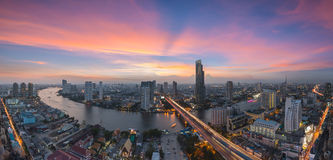Bangkok Transportation at Dusk with Modern Business Building alo. Ng the river (Thailand Stock Photography