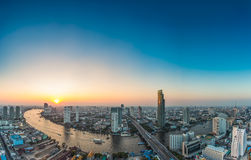 Bangkok. Transportation at Dusk with Modern Business Building along the river (Thailand Royalty Free Stock Photo