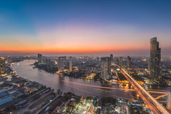 Bangkok. Transportation at Dusk with Modern Business Building along the river (Thailand Royalty Free Stock Photos