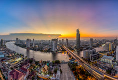 Bangkok Transportation at Dusk with Modern. Business Building along the river (Thailand Royalty Free Stock Photography