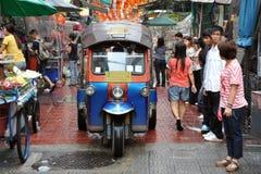 Bangkok Tuk-Tuk Taxi. A three-wheeled tuk tuk taxi drives along a busy road in Chinatown on Feb 4, 2012 in Bangkok, Thailand. Tuk tuks can be hired from as Royalty Free Stock Photo