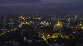 Bangkok Twilight, The Golden Mountain in the mist. (Wat Sraket, Thailand Stock Image