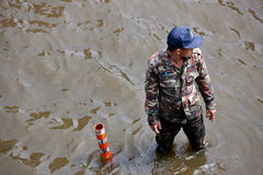 Bangkok Underwater. BANGKOK - NOVEMBER 5: An unidentified soldier stands on Phahonyothin Road to help people during the worst flooding in Bangkok, Thailand on royalty free stock photo