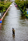 Bangkok Underwater. BANGKOK - NOVEMBER 5: Two unidentified soldiers stand on the road to help people get through the flood on Phahonyothin Road during the worst stock image