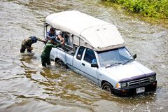 Bangkok Underwater. BANGKOK - NOVEMBER 5: Two unidentified Soldiers move the truck through the flood on Phahonyothin Road during the worst flooding in Bangkok stock images