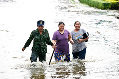 Bangkok Underwater. BANGKOK - NOVEMBER 5: An unidentified soldier helps two unidentified women during the worst flooding in Bangkok, Thailand on November 5, 2011 stock images