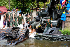 Bangkok Underwater. BANGKOK - NOVEMBER 5: A group of unidentified soldier builds a fence to protect flood during the worst flooding in Bangkok, Thailand on stock photos
