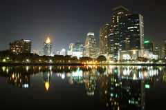 Bangkok urban scene at night with skyline reflection Royalty Free Stock Images
