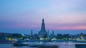 Bangkok Wat Arun temple with Chao Phraya River day to night time lapse in Bangkok, Thailand stock video