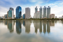 Bangkoks business district during sunset with water reflection Thailand Royalty Free Stock Photo