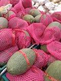 Bangkong, Tailândia - o 29 de maio de 2016: Importação fresca orgânica do melão Foto de Stock