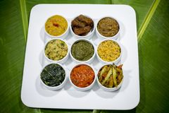 Bangla Cuisine Vorta, vaji, fish curry and vegetables curry platter. The fish is popular food amongst the people of South Asia and in the Middle East, but Royalty Free Stock Photo