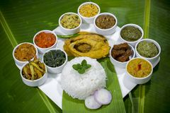 Bangla Cuisine Vorta, vaji, fish curry and vegetables curry platter. The fish is popular food amongst the people of South Asia and in the Middle East, but Stock Photo