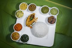 Bangla Cuisine Vorta, vaji, fish curry and vegetables curry platter. The fish is popular food amongst the people of South Asia and in the Middle East, but Stock Image