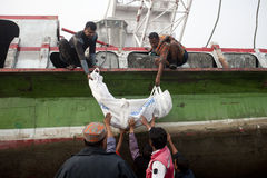 BANGLADESH-CAPSIZED BOAT-CASUALTIES-VICTIMS-PEOPLE. Bangladeshi rescue workers recover the body of a victim after a ferry accident at Paturia some 70kms east of stock photos
