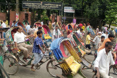 Bangladesh, Dhaka,. Dhaka, Bangladesh - September 17th 2007: Unidentified people on traditional rickshaws, cheap usual mode of transport Royalty Free Stock Photo