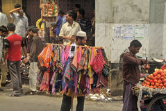 Bangladesh, Dhaka,. Dhaka, Bangladesh - September 17th 2009: Unidentified people on traditional street market with fruits, shoes and blankets Royalty Free Stock Image
