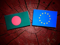 Bangladesh flag with EU flag on a tree stump isolated. Bangladesh flag with EU flag on a tree stump Royalty Free Stock Photography