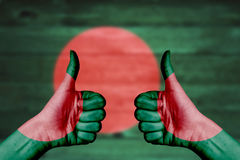 Bangladesh flag painted on female hands thumbs up Stock Photography