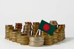 Bangladesh flag with stack of money coins Royalty Free Stock Photo