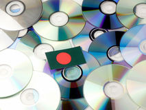 Bangladesh flag on top of CD and DVD pile isolated on white Stock Photos