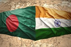 Bangladesh and India. Waving Bangladesh and Indian flags of the political map of the world Stock Images