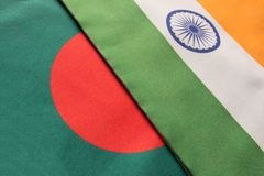 Bangladesh and Indian flags placed on table stock photos