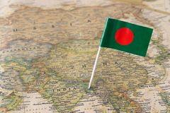 Bangladesh flag on a map. Bangladesh paper flag pin on a map. Officially the People`s Republic of Bangladesh is a country in South Asia Royalty Free Stock Photos