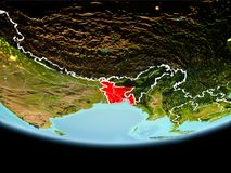 Bangladesh in red in the evening. Country of Bangladesh in red on planet Earth in the evening with visible border lines and city lights. 3D illustration Stock Images
