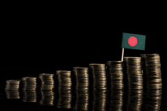 Bangladeshi flag with lot of coins isolated on black Royalty Free Stock Photography