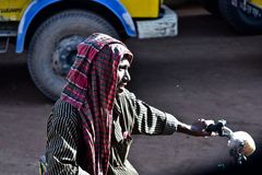 A poor rickshaw puller sitting on his vehicle unique photo. A Bangladeshi man sitting on his rickshaw beside a road isolated unique photo royalty free stock photography