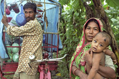 Bangladeshi mother and baby and street trader Royalty Free Stock Photography