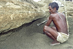 Bangladeshi older man working in gravel quarry. Bangladesh, Tangail city: Portrait, closeup, of an elderly Bengali male who works in a gravel pit. Outdoor mining Stock Images