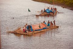 People travelling on a traditional boat in the river unique photo. Bangladeshi people travelling on a boat around a river in the afternoon unique editorial image royalty free stock photography