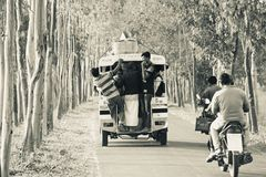 Bangladeshi people are travelling on the street unique photo. Urban areas people are travelling on the street in Bangladesh isolated unique editorial photo royalty free stock photography