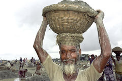 Bangladeshi senior man working in gravel pit Royalty Free Stock Photos
