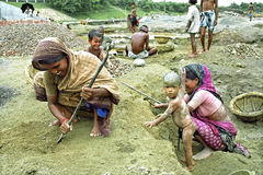Bangladeshi women working with kids in gravel pit Royalty Free Stock Image