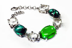 Silver bangle with brilliants and green stones Royalty Free Stock Photos