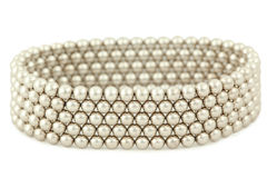 Bangle from silvery beads lies on white Royalty Free Stock Photography
